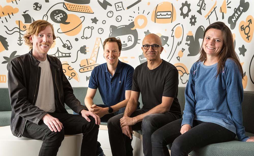 GitHub's Founders with Microsoft CEO Satya Nadella and CFO Amy Hood